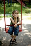 Little boy sitting on a swing Royalty Free Stock Photos