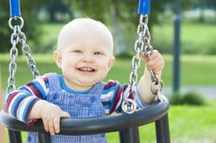Little boy sitting on a swing Royalty Free Stock Images