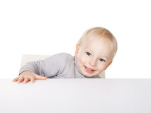 Little boy sitting at table Stock Photos