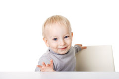 Little boy sitting at table Royalty Free Stock Images
