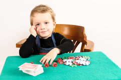 Little boy playing poker Stock Photo