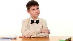 Little boy sitting at the table and sighing, on stock video footage
