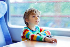 Little boy sitting in train and going on vacations Royalty Free Stock Photos