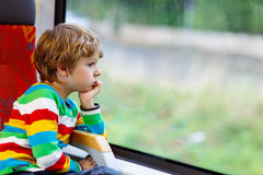 Little boy sitting in train and going on vacations Royalty Free Stock Photo