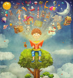 Little boy sitting on the tree and  reading  book, objects flyi. Little boy sitting on the tree and  reading a book ,objects flying out Royalty Free Stock Photos