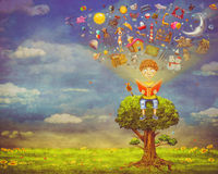Little boy sitting on the tree and  reading a book. Objects flying out Royalty Free Stock Photo