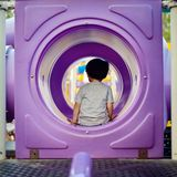 Little boy sitting in the tunnel royalty free stock photography