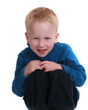 Little boy sitting on white background Stock Images