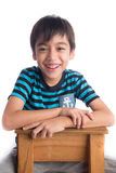Little boy sitting on the wood chair on white Royalty Free Stock Photos