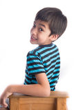 Little boy sitting on the wood chair on white Stock Images