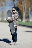 Little boy with skateboard on the street Royalty Free Stock Photography