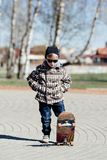 Little boy with skateboard on the street Royalty Free Stock Images
