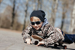 Little boy with skateboard on the street Royalty Free Stock Photo