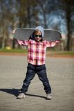 Little boy with skateboard on the street Royalty Free Stock Photos