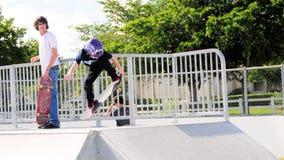 Little boy skateboarder hand up Stock Photo