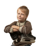 The little boy with the skates in sweater. Royalty Free Stock Image