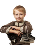 The little boy with the skates in sweater. Royalty Free Stock Photography