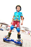Little boy skating on gyroscooter. And smiling Royalty Free Stock Photography