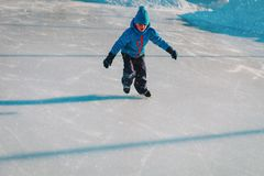 Little boy skating on ice in winter. Nature, seasonal sport royalty free stock photography