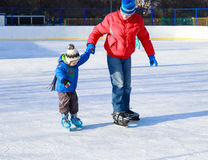 Little boy skating with parent Royalty Free Stock Images