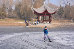 A little boy skating Stock Images