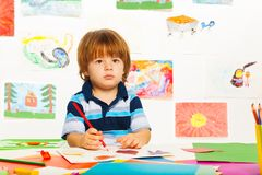 Little boy sketching Stock Photos
