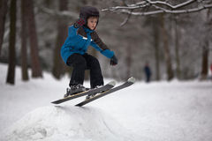 Little boy skier on ski-jump Stock Images