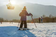 Little boy skiing down the hill royalty free stock photo