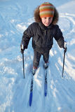 Little boy skiing and smiling at winter Stock Photos