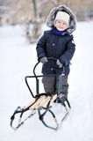 Little boy with sled in winter Stock Photography
