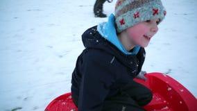 Little Boy Sledding Backwards stock footage