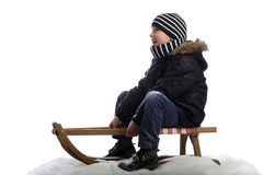 Little boy on sledge Stock Photo