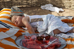 Little boy sleeping on the beach Royalty Free Stock Photo