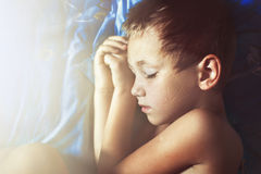 Little boy sleeping in bed Royalty Free Stock Photos