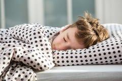 Little boy sleeping in bed stock image