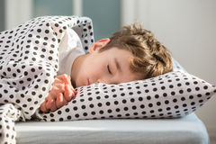 Little boy sleeping in bed stock photos