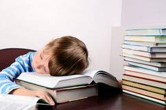 Little boy sleeping on books Stock Photo