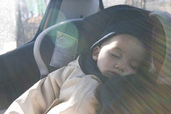 Little boy sleeping in car Royalty Free Stock Images