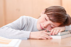 Little boy sleeping on desk Royalty Free Stock Images