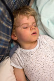 Little boy sleeping in his bed Royalty Free Stock Image