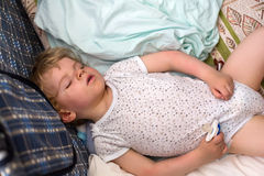 Little boy sleeping in his bed Stock Photos