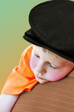 Little Boy Sleeping. A little boy sleeping on his daddies shoulder stock photography