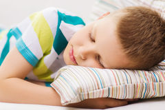 Little boy sleeping at home Stock Images
