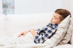 Little boy sleeping at home Stock Photos