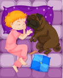 Little boy sleeping with pet dog in bed Stock Photography