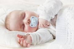 Baby sleeping covered with soft blanket Stock Image