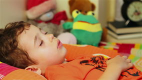 Little boy sleeping. Two years old boy sleeping tight stock footage
