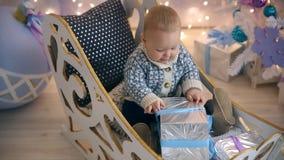 Little boy sleigh Christmas gift stock video