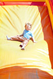 Little boy on a slide Stock Photo