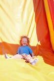 Little boy on a slide Stock Photos